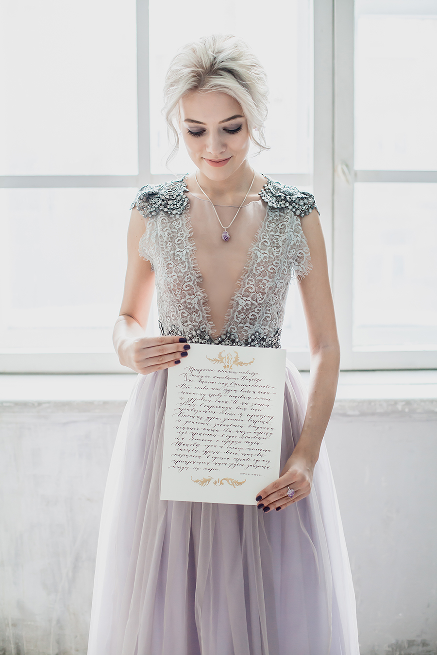 romantic winter wedding inspiration - bride holding marriage license