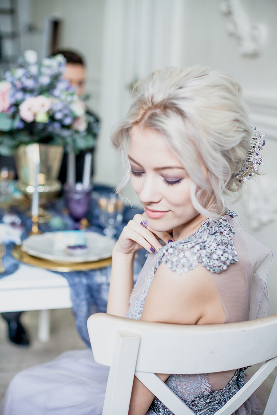romantic winter wedding inspiration - bride in chair posing for photo
