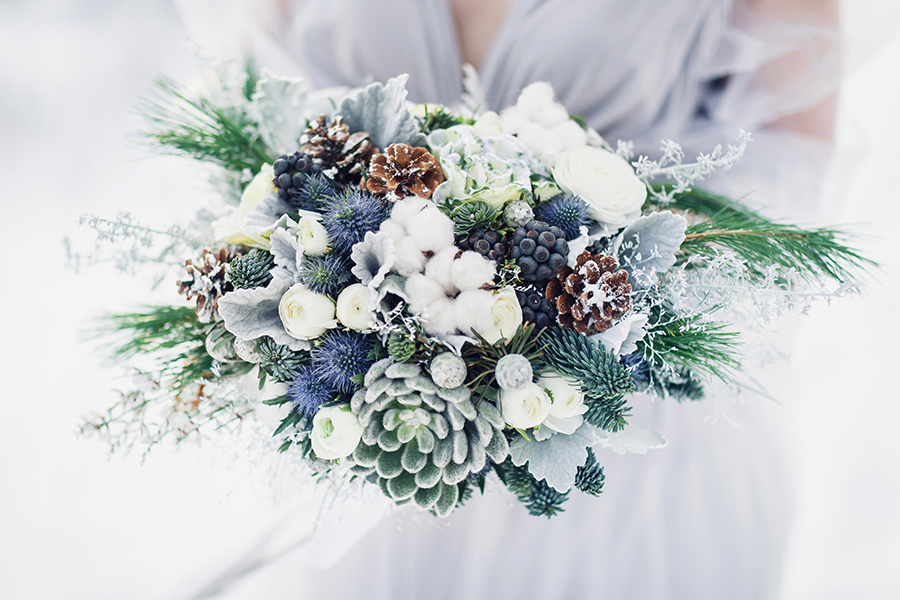 Winter Wedding Bouquet Featuring Pine Cones Succulants And Greenery