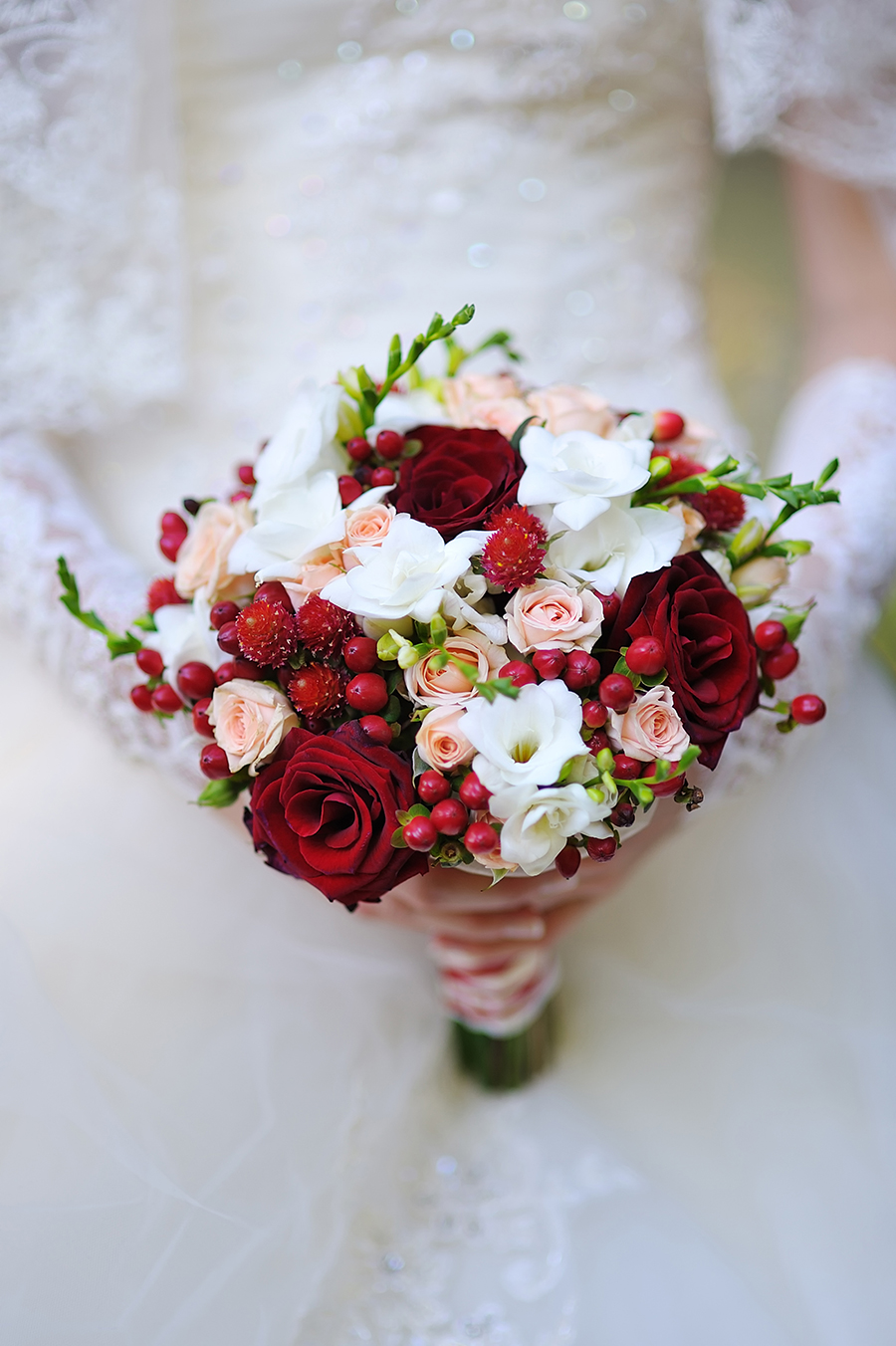 Winter Wedding Bouquet with beautiful red berries and roses