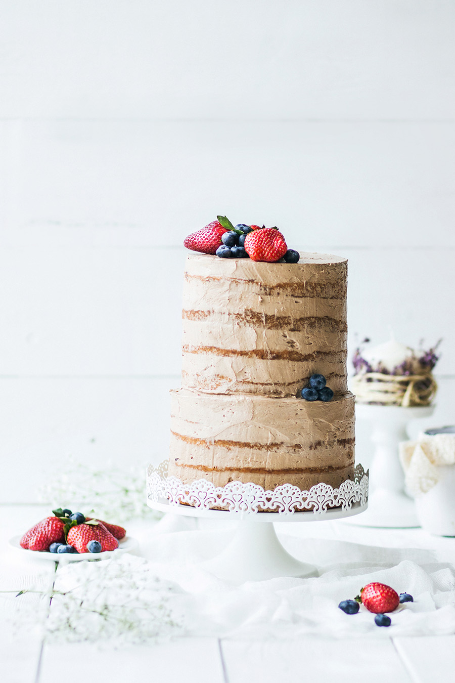 sweet rustic wedding cake with strawberries