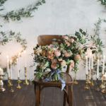 Peach, Periwinkle and Gold Wedding Inspiration candles and bouquet