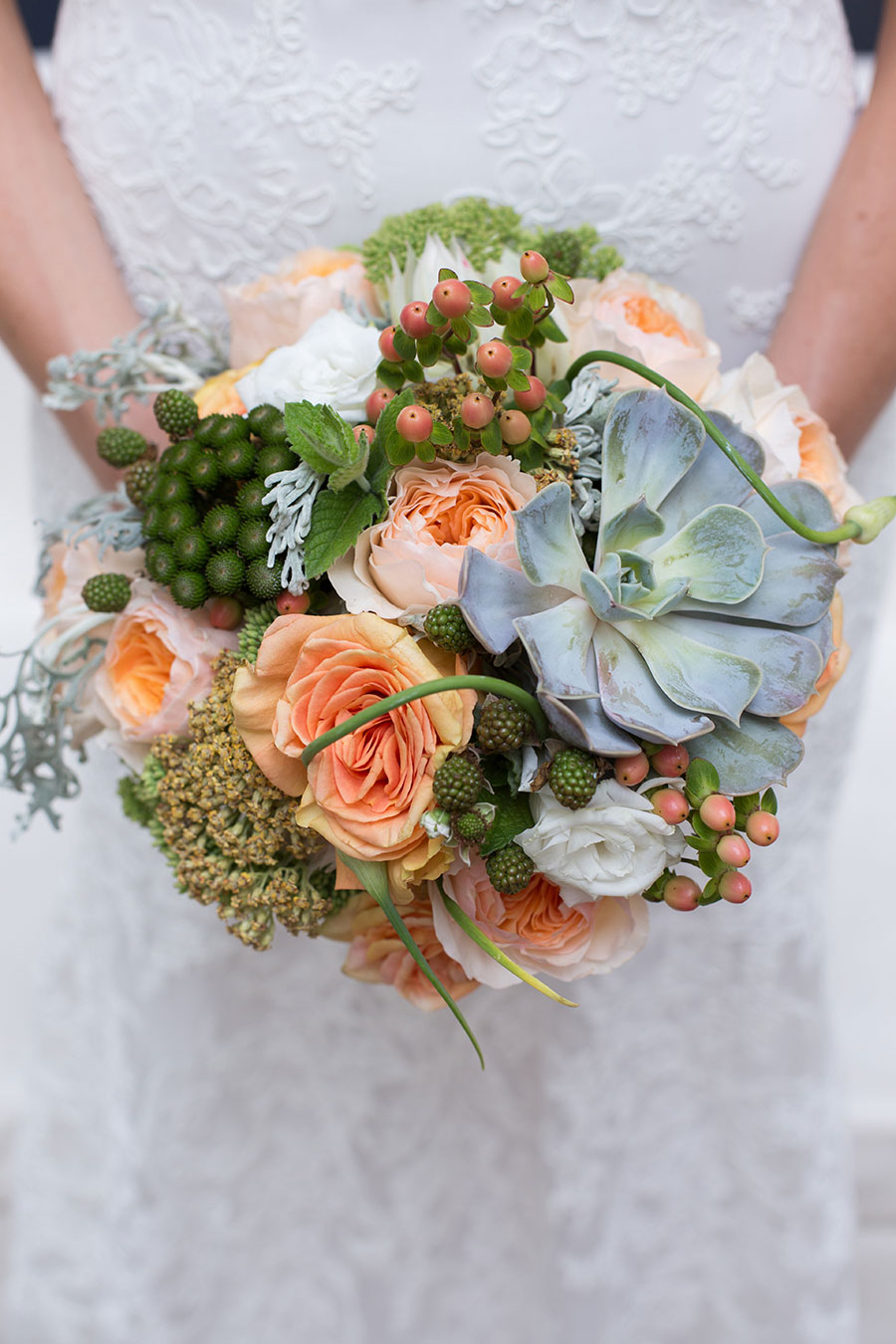 Succulent Wedding Bouquet with peach roses