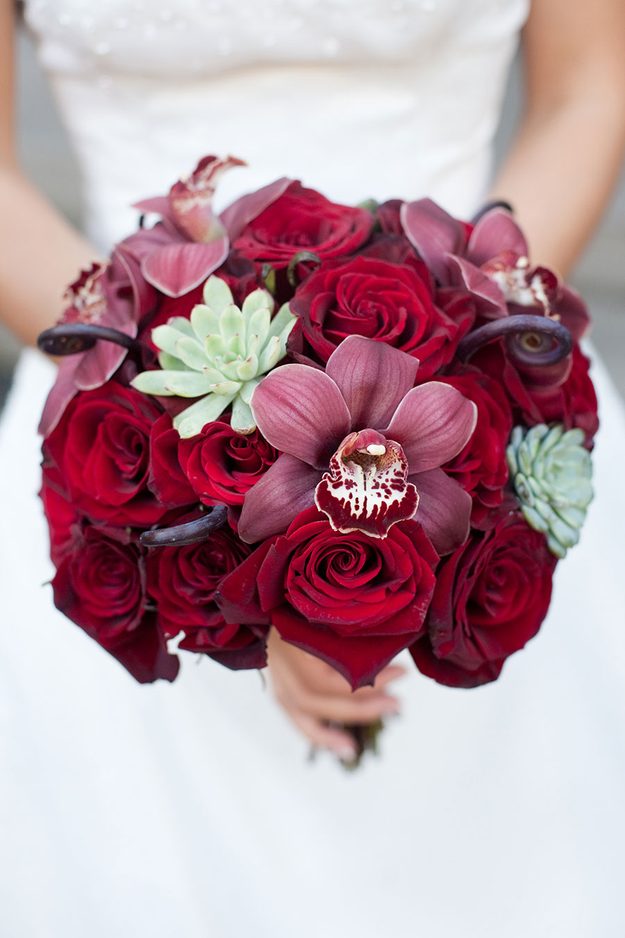 Succulent and red rose wedding bouquet