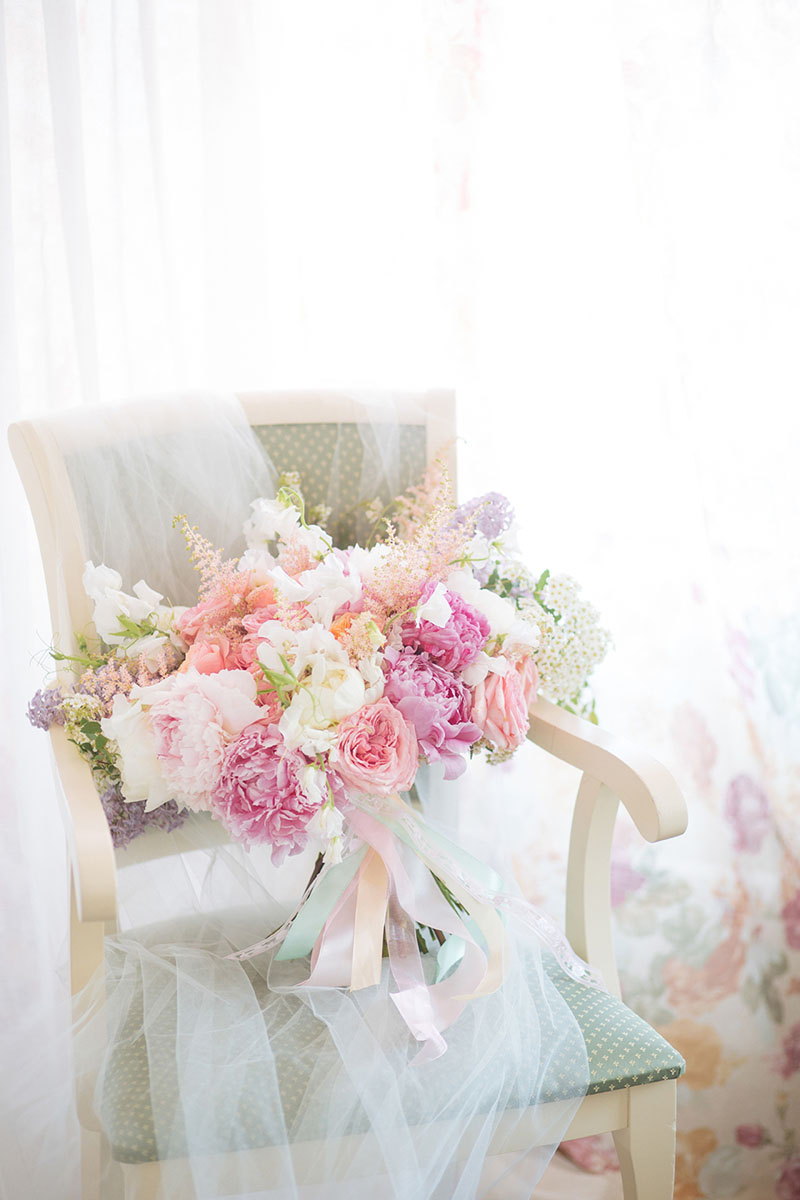 Pretty Pastel Wedding Inspiration - pastel bouquet on chair