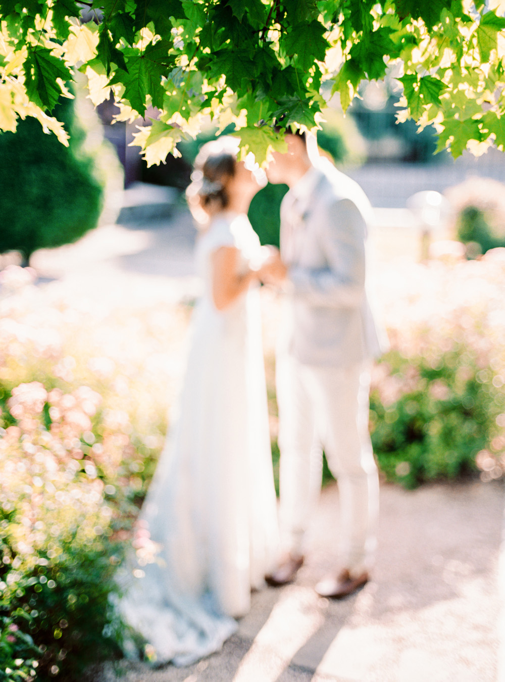 Romantic Blue Lakeside Wedding Inspiration - Couple Kissing