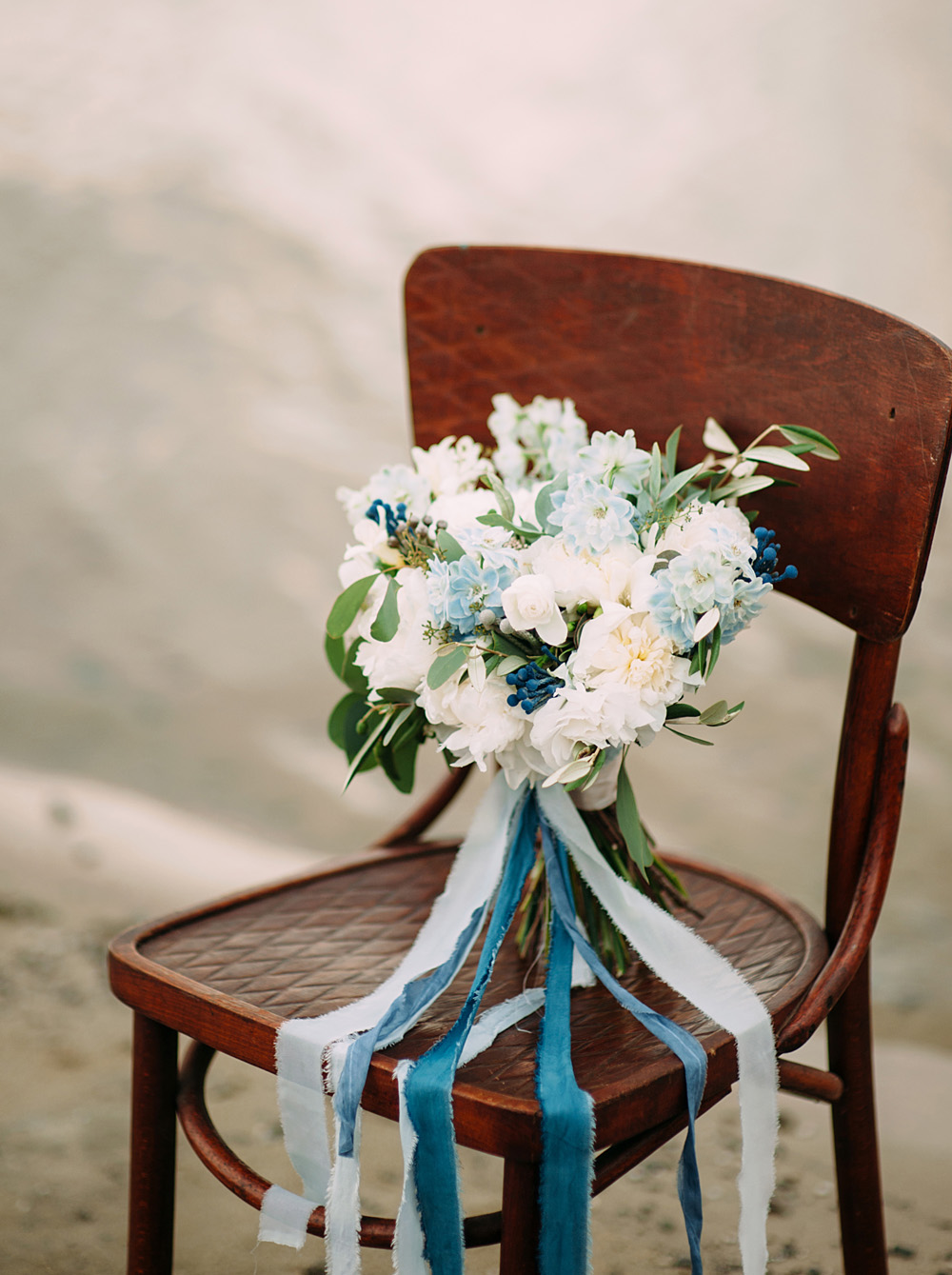 Romantic Blue Lakeside Wedding - Bouquet on Chair