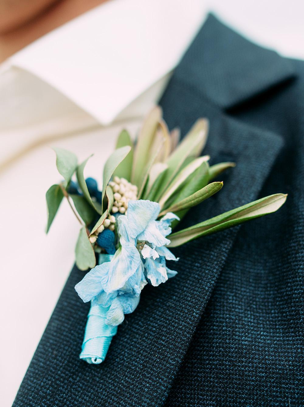 Romantic Blue Lakeside Wedding Inspiration - blue boutonniere